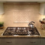 Decorative tile inlay above cooktop