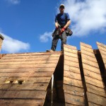 Tearing off old 2x4 rafter roof to add dormer